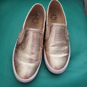 Guess gold slip ons